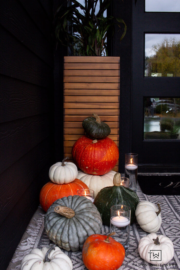 Moody fall porch with pumpkins and candle display